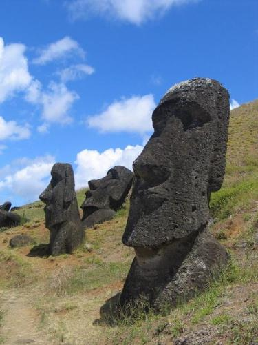 "Moai Rano raraku - Moai are statues carved from compressed volcanic ash on Rapa Nui, Chile (Easter Island). The statues are all monolithic, that is, carved in one piece. The largest moai erected, ""Paro"", was almost 10 metres (33 feet) high and weighed 75 tonnes (74 Imperial tons, 83 American tons).[1] One unfinished sculpture has been found that would have been 21 metres (69 ft) tall and would have weighed about 270 tons.