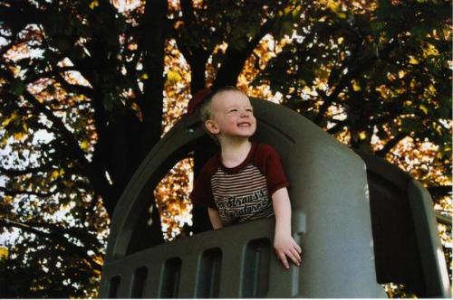 My best picture - This was taken in April-May 2006 in my backyard. My son was 2 1/2 at the time and he's playing on his swingset under our tree.