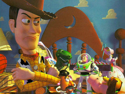 Woody and the gang from Toy Story - This is a picture from the movie Toy Story, in this particular picture, Woody is not as impressed as all the other toys are about the new toy that their owner Andy got for his birthday!