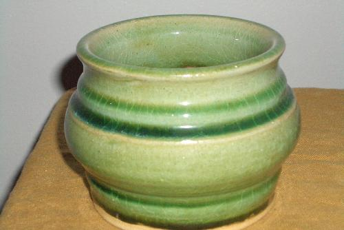 ceramic bowl, handmade - homemade handmade ceramic bowl, green glaze, food safe glaze, wheel thrown.  I love ceramics and I love making pieces like this to give to friends as little gifts.  This is one of my earlier peices, so it's not as well finished, but I love the green!