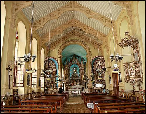 This old church's design and architecture. - The MEMORIA Of ITS WIFE MARIA ESCLASTICA WOLF. BEEN BORN IN 28-2-1900 DEAD IN 10-11-23 PRETTY SON COELOHO BORN IN S-N- 1923 DEAD IN 17-10 -31 LAGRIMASE SOUDADESDO ESPOSOEPAE RODOLFO SEBASTEAO PABLO RABBIT IBRAMEMADRASTA MAREA TEODOUINDA WOLF.