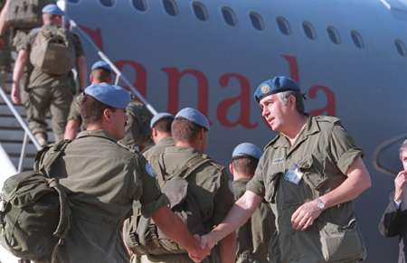 Peacekeepers - Canadian Peacekeepers boarding a plane bound for Canada from Split, Croatia, in 1995 following the end of their UN mandate in the region.