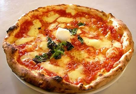 Pizza Margherita - This is how a real Neapolitan Pizza Margherita should look like.