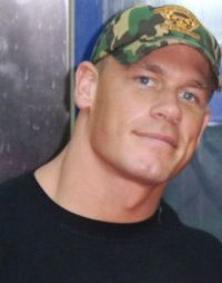 """cena - John Felix Anthony Cena, Jr. (born April 23, 1977), is an American professional wrestler, rap music artist and actor who wrestles on the RAW brand of World Wrestling Entertainment (WWE), where he is the reigning WWE Champion. Cena's first televised WWE match was in answer to an open challenge by Kurt Angle on June 27, 2002. Inspired by Vince McMahon's speech to WWE's rising stars, exhorting them to show """"ruthless aggression"""" to earn a place among the legends, Cena took advantage of the opportunity and almost beat Kurt Angle kicking out of the Angle Slam and enduring the ankle Lock submission hold, but ultimately lost to a hard, amateur-style pin.  Cena then played the role of a typical underdog face in each match. After losing alongside Billy Kidman in a tournament match for the WWE Tag Team Championships, Cena turned heel, blaming Kidman for the loss. Shortly after his heel turn, on a Halloween episode of SmackDown!, he performed a freestyle rap for Stephanie McMahon while wearing a Vanilla Ice costume prompting a gimmick change to a white rapper. At first, this gimmick got Cena heel heat from the fans, but his frequent comical """"freestyles"""" about other wrestlers helped to gain him a following. During this time Cena adopted the classic WWF logo (without the """"F"""") along with the slogan """"Word Life"""" as his """"signature symbol"""". He was joined by an enforcer, first B-2 (also written as B², pronounced """"B-Squared""""), who was later replaced by Rodney Mack under the moniker """"Red Dogg""""."""