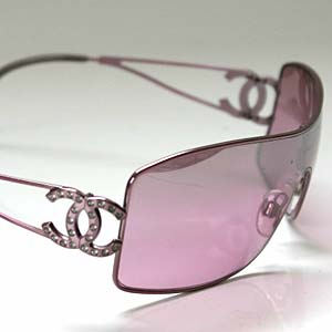 a trend setting glass - Here you see a brand new pair of pink Chanel sunglasses for the year 2006. These sunglasses feature a wide-lens, that is a very fashionable look in the last 2 years. They have two frame arms in a matching pink color, and the signatue Double C's made famous by CoCo Chanel that have diamonds, about 4 Karots worth. This pair of chanel sunglasses retails for $295.00 plus tax