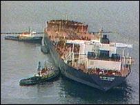 Court halves Exxon spill damages - Court halves Exxon spill damages