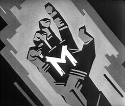 """Finger M for Murder - A hand with a chalked """"M"""""""