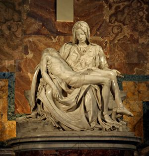The Pietá - Photo of Michaelangelo's statue of the Pietà in St. Peter's Basilica in Rome.  It is a considered his best work and it shows Mary seated holding the stretched out of the body of Christ after he was crucified.