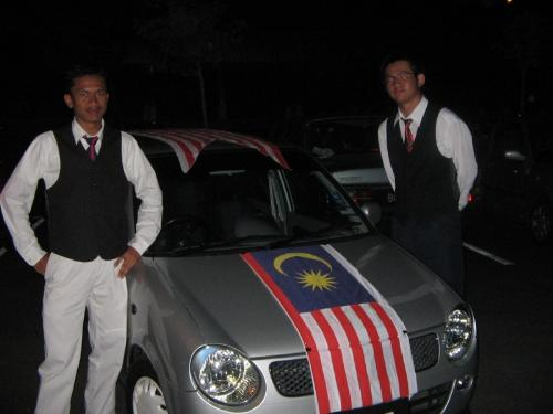 The national flag - That is the national flag of Malaysia on Malaysia national car, Perodua with two Malaysians. But not me.