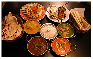 Indian Food and Spices - Here we have pictured is a table with some indian food and spices on it.