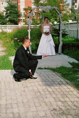 This is an imagine from a wedding,from my country - This is an imagine from my country,Romania.At this wedding the bride was very young and her husband,too.They are very happy and their parents helped them very much to do this wedding and for have a house.They are very young and they love one of each other.I think that this wedding is an example for others.