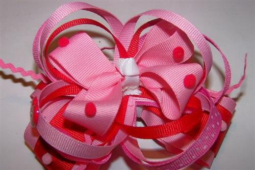 Valentine Bows - Funky Bows with many different types of ribbon, ric-rac, hearts and pom-poms.  All hand sewn and ends are treated to prevent fraying.