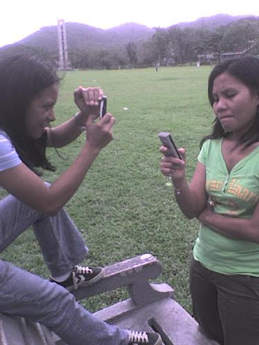 Mobile Phone SMS Addicts - My friends Lucy and Cora. I took this photo of them in UPLB early this year.