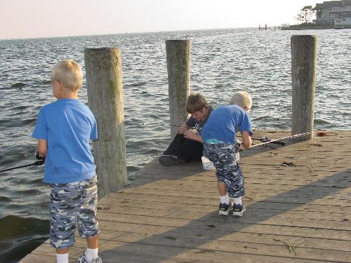 3 on a dock - This is my 3 children.  The oldest is baiting his hook, the youngest is untangling his line and the middle one is actually fishing!