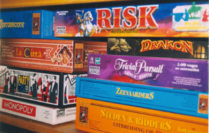 "Board Games - A board game is a game played with counters or pieces that are placed on, removed from, or moved across a ""board"" (a premarked surface, usually specific to that game). Simple board games often make ideal ""family entertainment"" since they are often appropriate for all ages."