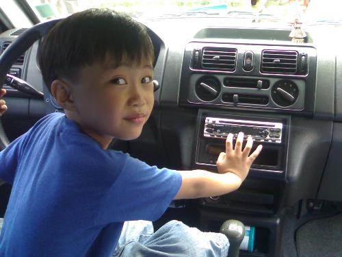 my son, kurt - he's enjoying the fun of driving as if he knows how to drive