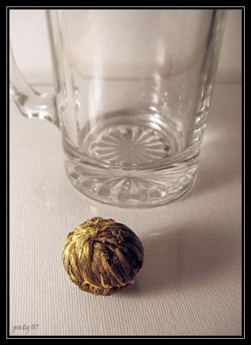 tea ball - tea ball: green tea and jasmine blooming tea. photo by me!
