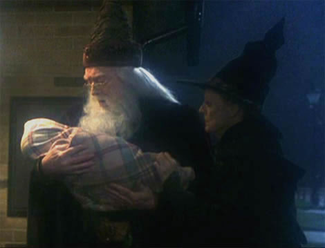 At the doorstep - Dumbledore with Harry as a small boy in first movie.