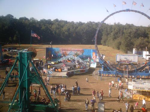 Carnival  - From birds eye view me over looking the carnival while riding the ferris wheel.