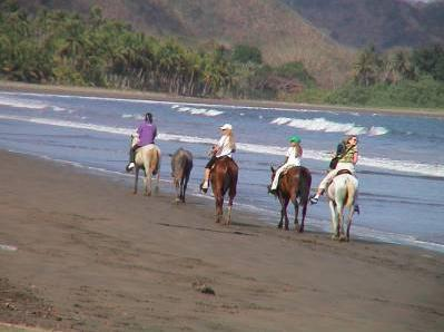 Me (in the middle) in Costa Rica ! - That was unforgettable too ! I had just start horse riding 5 months before, and I could ride and canter on the beach !
