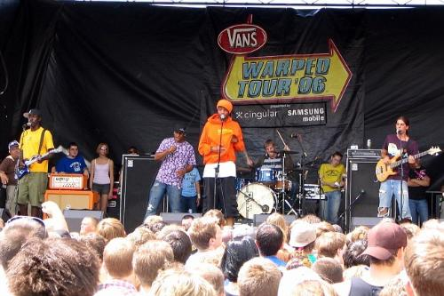 my sis and Gym Class Heroes - My sister on stage with the band Gym Class Heroes at the Vans Warped Tour 2006.