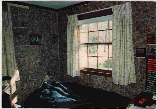 Ken's Room - Here is the bedroom that I slept in when I was younger and lived with my parents. On the wall is my artwork that I did on regular looseleaf paper.