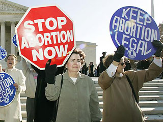 Protesters on the abortion issue. - Pro and anti oppinions abut the legality of abortion.
