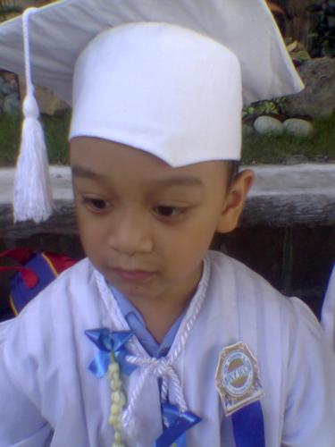 my sons graduation pic - my son's graduation pic from nursery