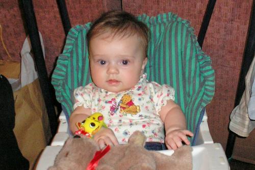 Baby at Grandmas house - Swinging in her swing