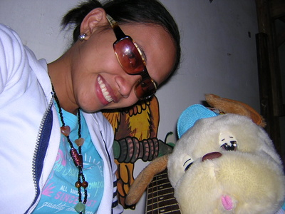 "me and my Doggie Bear - This is my ""bed mate"" if there is such term. lol. We share the same bed and always sleeps beside each other. He waits for me everytime I come home from work. I wish he is real. :)"