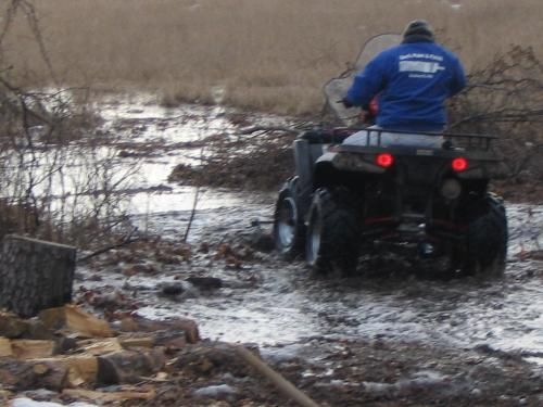 fun in spring - my sweety clearing some mud from the flood we had