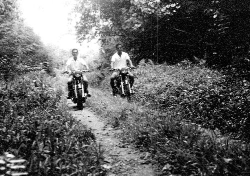 Biking Through The Jungles of New Guinea - My Dad and his friend on their motor cycles making their journey through the jungle in Hollandia, New Guinea.