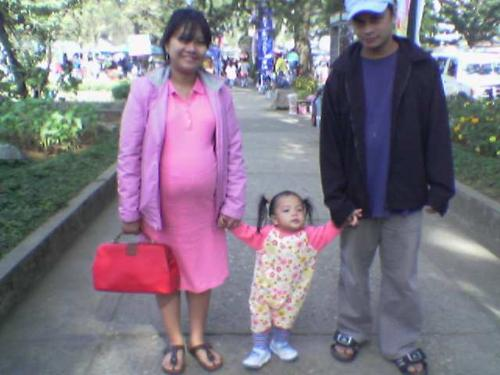 Me and my big tummy.. (also with my daughter and h - A picture of me and my husband and daughter taken at Burnham Park, Baguio City, Philippines last February 2007.. I was only 6 months pregnant in this picture, but see how big my tummy was.. (n_n)