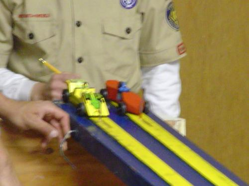 Pinewood Derby cars ready to race. - There's nothing like the excitement and fun of a Pinewood Derby.