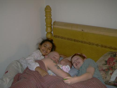 kids and fiancee - this is a picture of my children and my fiancee.