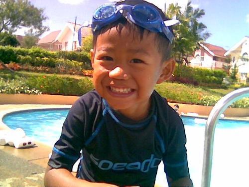 wet kid - boy swimming