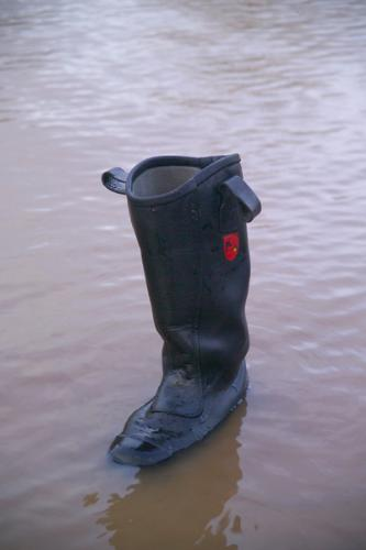 Flood Havoc - The Boot of a rescue person,who lost his life in flood.