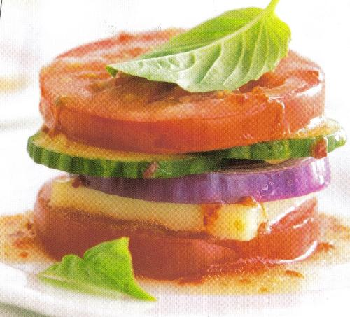 Tomato Sandwich - Appears to be a tomato sandwich with cucumber, onion, cheese and some kind of salad dressing poured over it.