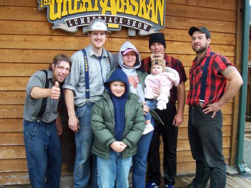 Us with the loggers at one of the shows - One of the shows, the logging show