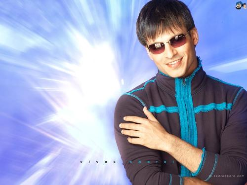 vivek - vivek is looking very smart in the picture he is rocking, he is one of the best actor