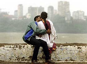 Romance in public... - A young couple shows affection in public.