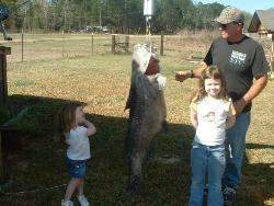 pic of a fish my dad caught - blue cat my dad caught with my 2 girls beside it