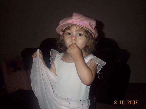 my baby princess - here she is in here princess dress and ofcourse her hat lol