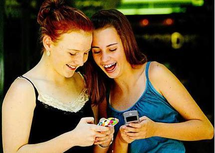 texting friends - two friends in the pic enjoy texting a lot.