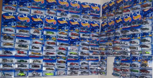 Hot Wheel Cars - There are over 100 cars hanging on the wall.