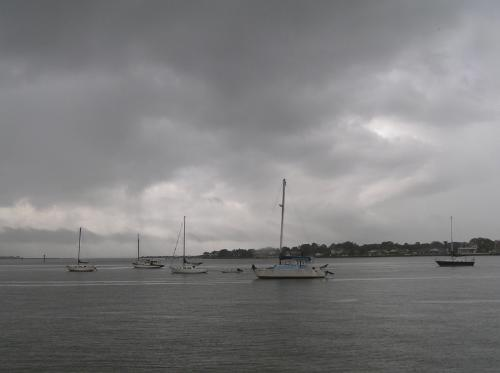 boats riding out a rainstorm - Many boats were moored out in the bay in St. Augustine. No one was doing much sailing in the rain.
