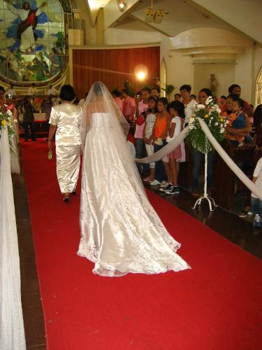 wedding and being single - a bride walking in an aisle