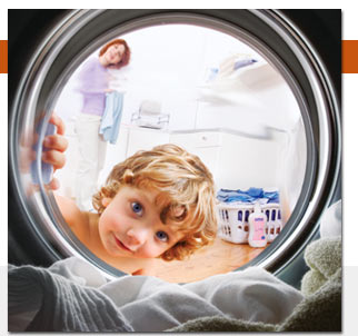 a girl and a dryer - A little girl looking into a running dryer