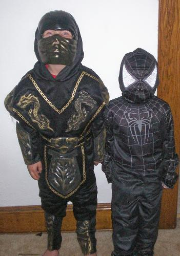My Boys wish You a Happy Haloween! - These are my boys. They are a Black Ninja and Black spidernam. Arnt they cute?!