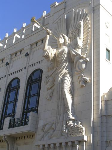 Angel on a bulding. -  This angel is sculpted on a building in Ft. Worth, Texas. It is huge. (The building is three stories high.) I thought it was so beautiful, I took several pictures of it with my digital camera.
